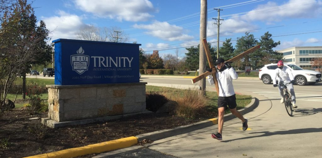 Josh Michaelis entering Trinity after a 40 mile run photo.