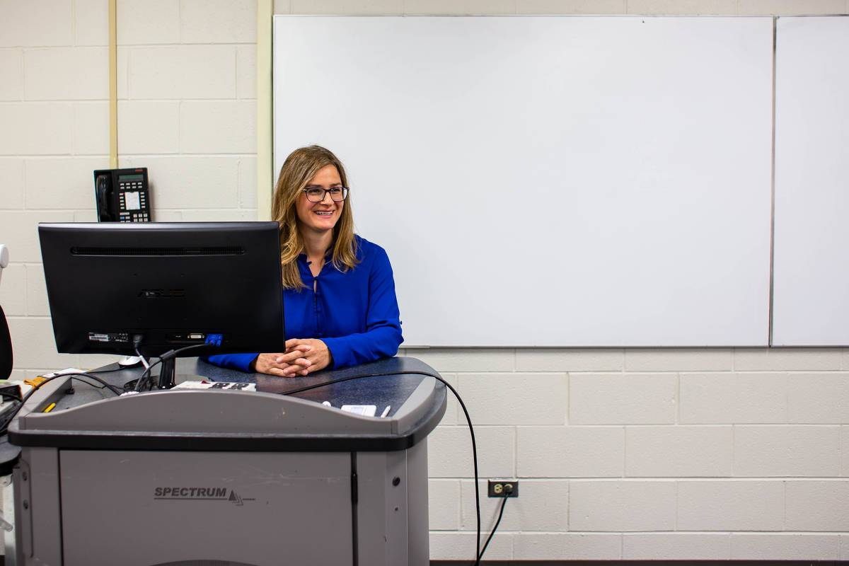 Dr. Stanculescu teaches from a classroom lectern