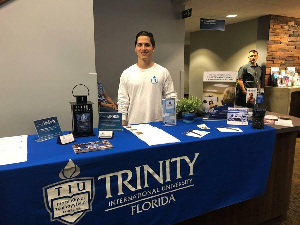 Photo of Tulio manning a TIU Florida table